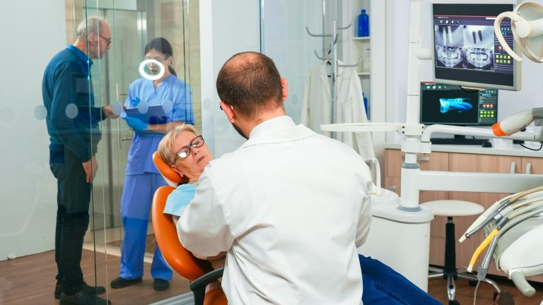 Doctor and patient talking about denture problems